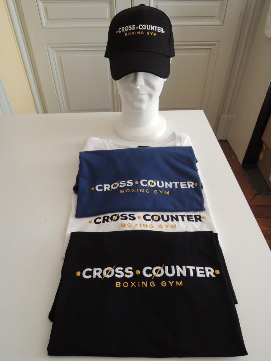 Tshirt casquette brodés au logo d'un club de boxe